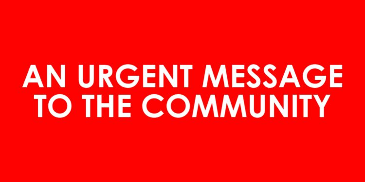 """Text stating """"an urgent message to the community"""" on red block"""